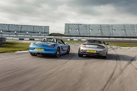 icon buyer new porsche boxster vs used aston roadster car