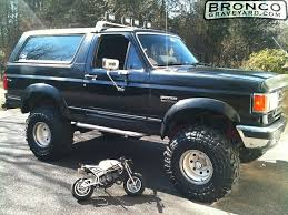 1988 ford bronco lifted with kc lights manly board