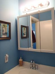 bathroom lighting above 2 medicine cabinets interiordesignew com