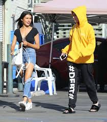 the halloween store spirit madison beer in super ripped jeans at the halloween spirit store