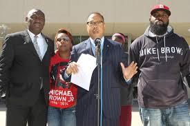 parents of michael brown file wrongful death suit st louis