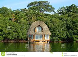 tropical bungalow over water thatched roof stock photo image