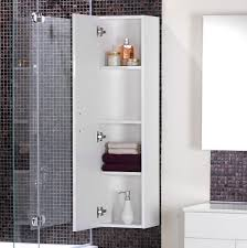 white wooden shower room cabinet with shelves hang on black glass
