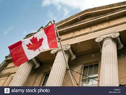 canadian flags flying at canada house trafalgar square london uk