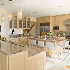 vallon paired tiger u0027s eye maple cabinets with marble like granite