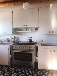 how do you fill the gap between kitchen cabinets and ceiling building cabinet cubbies for storage door sixteen