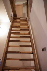 interior simple home stair design with brown oak tread covers and
