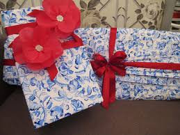 gift basket wrapping paper gift wrapping with pretty fabic flowers giftwrapping flowers