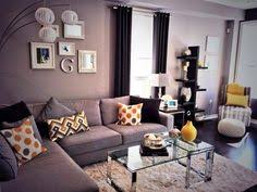 The Carmichael Sofa With Tangerine Dream Colour Story Accents - Urban living room design