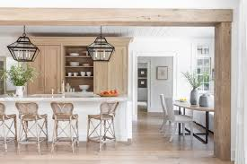 white kitchen cabinets with wood beams open plan kitchen features a large wood beam that
