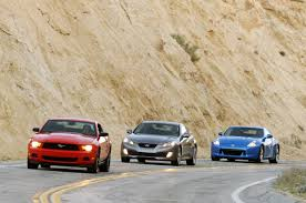 hyundai genesis vs nissan 370z ford mustang v6 takes on hyundai genesis coupe 3 8 and nissan 370z
