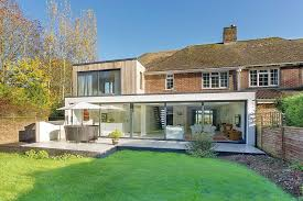 modern extensions classic home with brick façade acquires a nifty modern