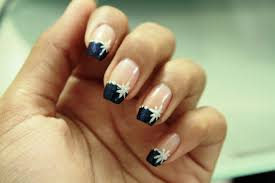 gold nails with black tip and white flowers winter nail art