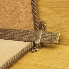 tudor antique brass finish dark wood stair carpet runner rods