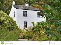 english white cottage in woodland royalty free stock image image