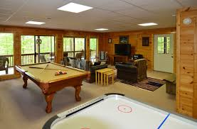 comfy video game room design ideas with arcade console and red