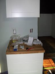 installing ikea kitchen cabinets finishing butcher block these countertops are no longer available but lots of others are check out this full post about ikea butcher block countertops for all the gory details