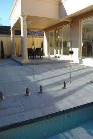 dark grey granite pavers around the swimming pool granite