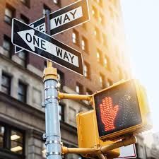 one way light new york city road sign one way with traffic pedestrian light on the