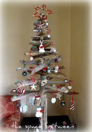 diy driftwood christmas tree with many diy ornamants tutorials