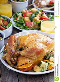 chicken thanksgiving dinner whole roasted chicken on dinner table stock photo image 55511911