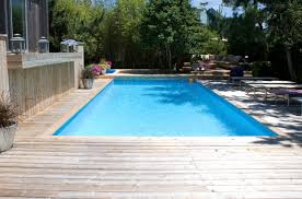 captivating wooden pool deck with modern outdoor rectangular pool