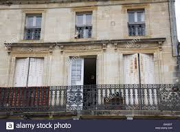 french windows with wooden shutters open and a balcony stock photo