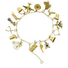 charm bracelet charms images Retro 14 karat yellow gold charm bracelet with moving charms for jpg