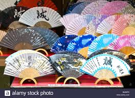 held fans held fans in japanese souvenir shop stock photo royalty free