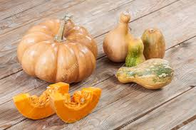 small pumpkins large and small pumpkins on wooden background stock photo picture