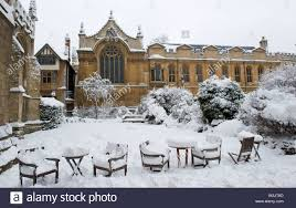 brasenose college seen across the snow in the gardens of radcliffe