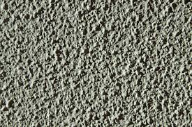 Grey Textured Paint - close up detail of texture of a grey wall paint stock photo