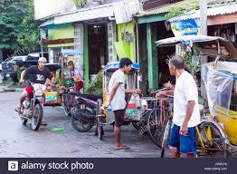Street Scene With Pedicabs And People Calbayog Samar
