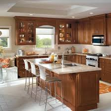 kitchen with brown cabinets look to homecrest for practical cabinetry solutions