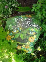 the earth laughs in flowers hand painted garden rock theres