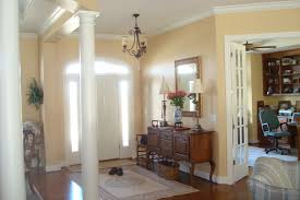 515 custom homes llc custom home building around des moines iowa the 45 degree angle of the dining room columns and the french doors into the study make for a wonderful open space inviting you into the