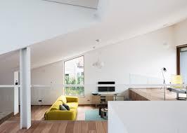 Decorating Split Level Homes by Sloped Green Roof Covers Split Level Home Living Room Decoration