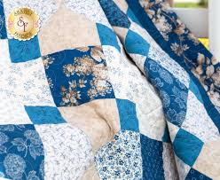 spinning 9 patch blue sky quilt kit