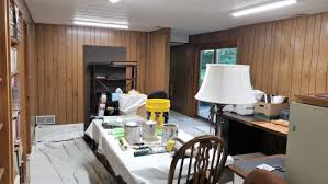 painting over kitchen cabinets transitioning wood paneling and kitchen cabinets to a painted finish
