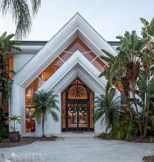 contemporary lakefront home ideally situated in exclusive pointe