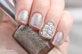 silver glitter nails with accent pearls nail art