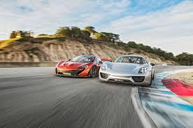 fastest lamborghini vs fastest ferrari 2015 mclaren p1 vs 2015 porsche 918 spyder comparison motor trend