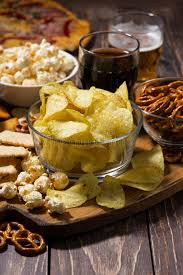 table snack cuisine assortment of snacks for fast food on wooden table stock photo