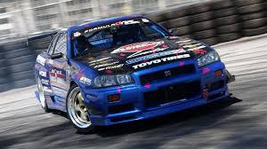 nissan skyline drift wallpaper nissan skyline r34 gt r drifting cars wallpaper 133732