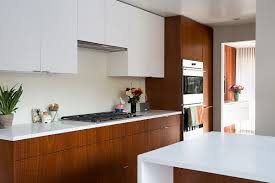 kitchen cabinets in white white and mahogany palette revitalizes 1962 eichler home in san