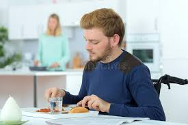 under the table jobs for disabled disabled man sat at dining table stock image image of seated