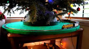 model train under christmas tree youtube