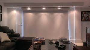 decorating white window trim with blackout roller shades and