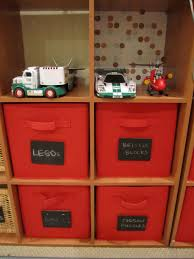 storage shelves with baskets for toys with red canvab storage bin
