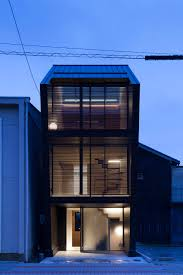 nest a family home by apollo architects set on a narrow lot in